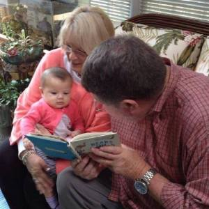 Joel and Vickie spending time with their young granddaughter